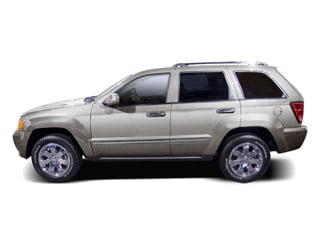 Bright Silver Metallic 2010 Jeep Grand Cherokee Pictures Grand Cherokee Utility 4D Laredo 2WD photos side view