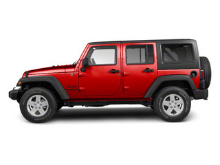 Flame Red 2010 Jeep Wrangler Unlimited Pictures Wrangler Unlimited Utility 4D Unlimited Sport 4WD photos side view