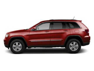 Deep Cherry Red Crystal Pearl 2012 Jeep Grand Cherokee Pictures Grand Cherokee Utility 4D Overland 2WD photos side view