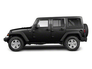 Black 2012 Jeep Wrangler Unlimited Pictures Wrangler Unlimited Utility 4D Unlimited Altitude 4WD V6 photos side view