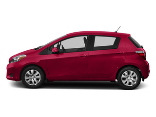 Absolutely Red 2013 Toyota Yaris Pictures Yaris Hatchback 5D LE I4 photos side view