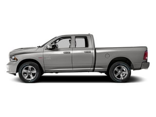 Bright Silver Metallic Clearcoat 2014 Ram 1500 Pictures 1500 Quad Cab Sport 4WD photos side view