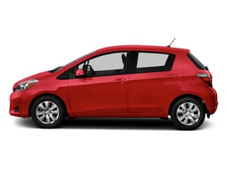 Absolutely Red 2014 Toyota Yaris Pictures Yaris Hatchback 5D SE I4 photos side view