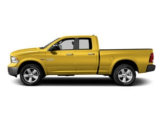 Yellow 2015 Ram Truck 1500 Pictures 1500 Quad Cab SLT 2WD photos side view