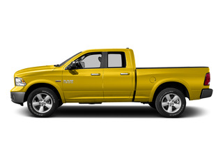 Yellow 2015 Ram Truck 1500 Pictures 1500 Quad Cab Express 4WD photos side view