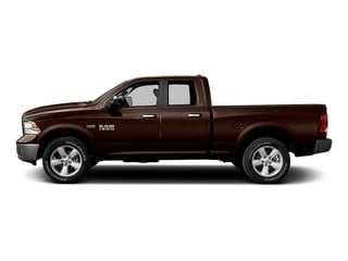 Western Brown 2015 Ram Truck 1500 Pictures 1500 Quad Cab SLT 4WD photos side view