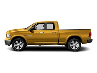 School Bus Yellow 2015 Ram Truck 1500 Pictures 1500 Quad Cab SLT 4WD photos side view
