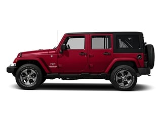 Firecracker Red Clearcoat 2016 Jeep Wrangler Unlimited Pictures Wrangler Unlimited Utility 4D Unlimited Sahara 4WD V6 photos side view