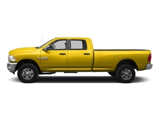 Yellow 2016 Ram Truck 3500 Pictures 3500 Crew Cab SLT 2WD photos side view