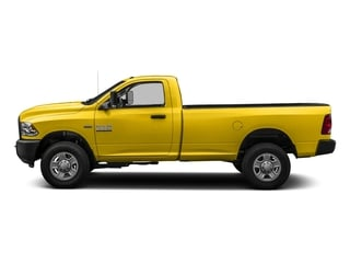 Yellow 2016 Ram Truck 3500 Pictures 3500 Regular Cab SLT 2WD photos side view