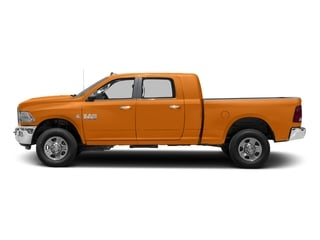 Omaha Orange 2016 Ram Truck 3500 Pictures 3500 Mega Cab SLT 4WD photos side view