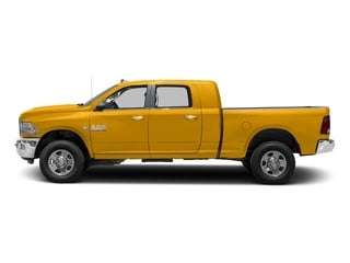 Construction Yellow 2016 Ram Truck 3500 Pictures 3500 Mega Cab SLT 4WD photos side view
