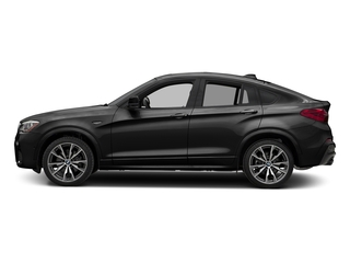 Black Sapphire Metallic 2017 BMW X4 Pictures X4 Utility 4D 28i AWD I4 Turbo photos side view