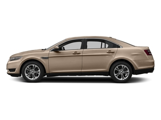 White Gold Metallic 2017 Ford Taurus Pictures Taurus Sedan 4D Limited AWD V6 photos side view