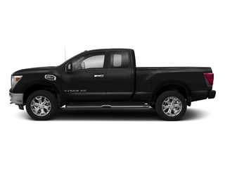 Magnetic Black 2017 Nissan Titan XD Pictures Titan XD Extended Cab PRO-4X 4WD photos side view
