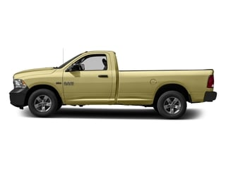 Light Cream 2017 Ram Truck 1500 Pictures 1500 Lone Star 4x2 Regular Cab 6'4 Box photos side view