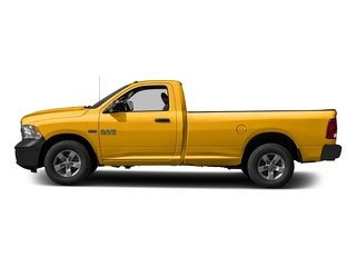 Construction Yellow 2017 Ram Truck 1500 Pictures 1500 Lone Star 4x2 Regular Cab 6'4 Box photos side view