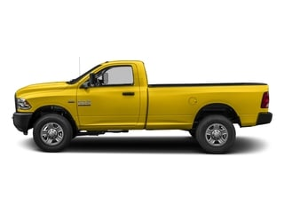 Yellow 2017 Ram Truck 3500 Pictures 3500 SLT 4x4 Reg Cab 8' Box photos side view