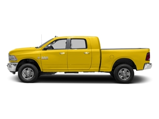 Yellow 2017 Ram Truck 3500 Pictures 3500 SLT 4x2 Mega Cab 6'4 Box photos side view