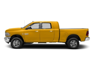 Construction Yellow 2017 Ram Truck 3500 Pictures 3500 SLT 4x2 Mega Cab 6'4 Box photos side view