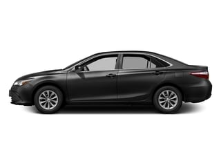 Midnight Black Metallic 2017 Toyota Camry Pictures Camry Sedan 4D XLE I4 photos side view