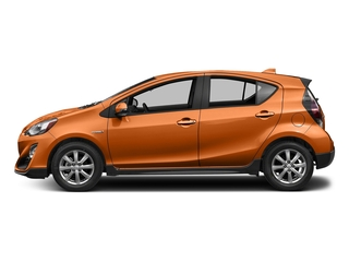Tangerine Splash Pearl 2017 Toyota Prius c Pictures Prius c Liftback 5D c Four I4 Hybrid photos side view
