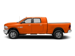 Omaha Orange 2018 Ram Truck 3500 Pictures 3500 Mega Cab Bighorn/Lone Star 2WD photos side view