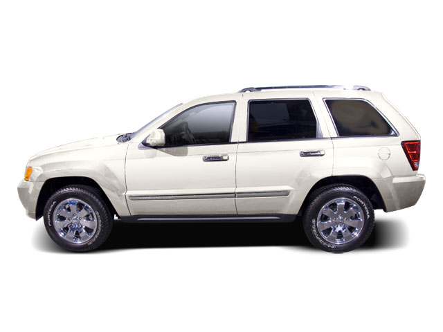 Stone White 2010 Jeep Grand Cherokee Pictures Grand Cherokee Utility 4D Laredo 2WD photos side view