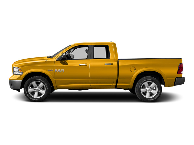 Construction Yellow 2015 Ram Truck 1500 Pictures 1500 Quad Cab SLT 4WD photos side view