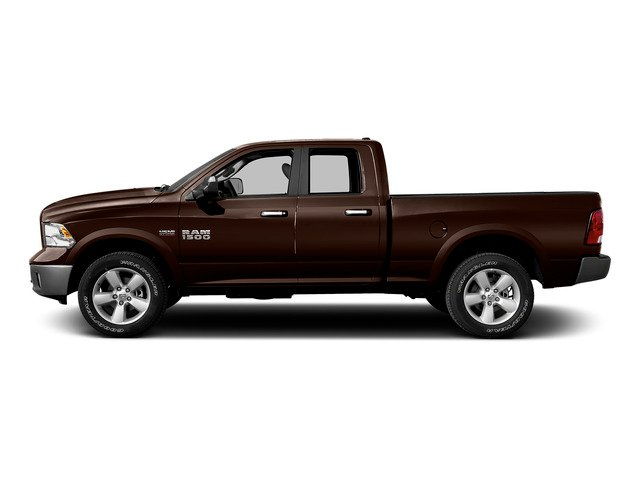 Western Brown 2015 Ram Truck 1500 Pictures 1500 Quad Cab SLT 2WD photos side view
