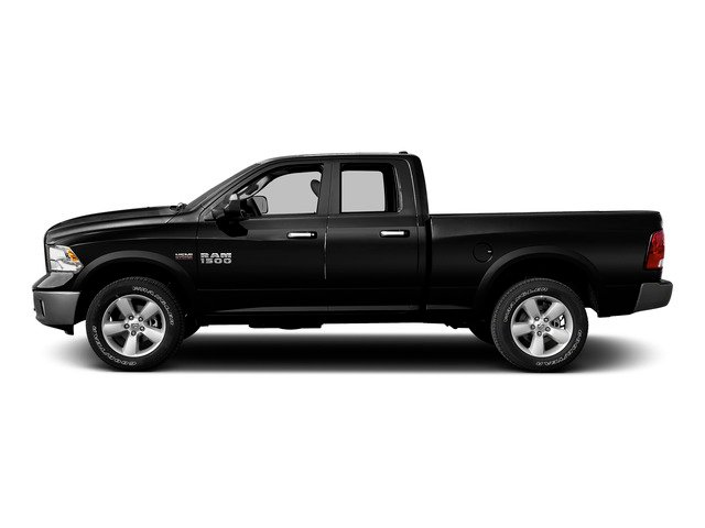 Black Clearcoat 2015 Ram Truck 1500 Pictures 1500 Quad Cab SLT 4WD photos side view