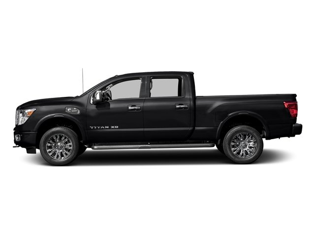 Magnetic Black 2017 Nissan Titan XD Pictures Titan XD Crew Cab Platinum Reserve 4WD photos side view
