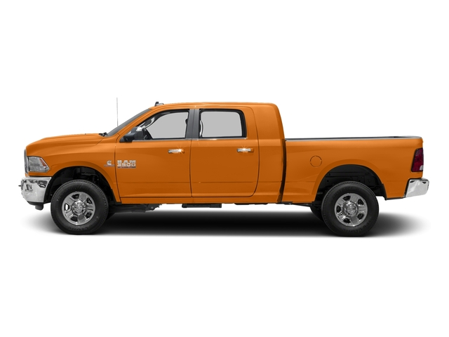 Omaha Orange 2017 Ram Truck 3500 Pictures 3500 Mega Cab SLT 4WD photos side view