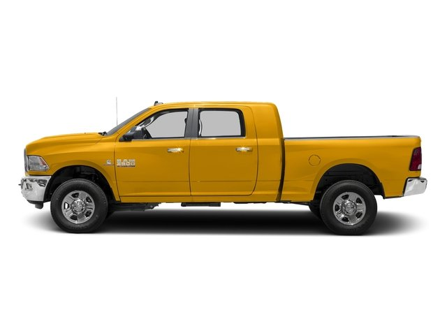 Construction Yellow 2017 Ram Truck 3500 Pictures 3500 Mega Cab SLT 4WD photos side view