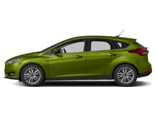 Outrageous Green Metallic Tinted Clearcoat 2018 Ford Focus Pictures Focus Titanium Hatch photos side view