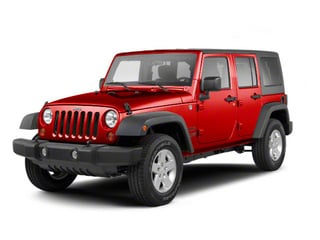 Flame Red 2010 Jeep Wrangler Unlimited Pictures Wrangler Unlimited Utility 4D Unlimited Sport 4WD photos front view