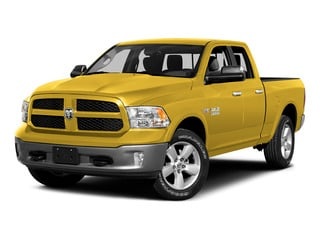 Yellow 2015 Ram Truck 1500 Pictures 1500 Quad Cab SLT 2WD photos front view