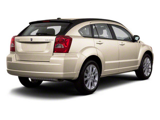 Light Sandstone Metallic 2010 Dodge Caliber Pictures Caliber Wagon 4D SE photos rear view