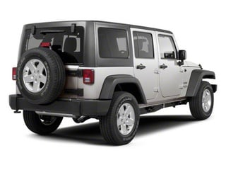 Bright Silver Metallic 2010 Jeep Wrangler Unlimited Pictures Wrangler Unlimited Utility 4D Unlimited Sport 4WD photos rear view