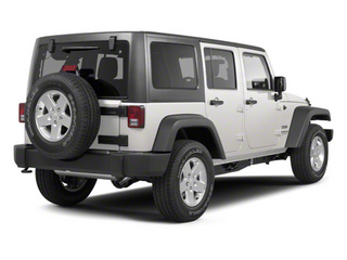 Stone White 2010 Jeep Wrangler Unlimited Pictures Wrangler Unlimited Utility 4D Unlimited Sport 4WD photos rear view
