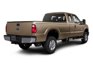 Pale Adobe Metallic 2011 Ford Super Duty F-350 DRW Pictures Super Duty F-350 DRW Supercab XLT 2WD photos rear view