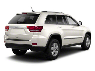 Stone White 2012 Jeep Grand Cherokee Pictures Grand Cherokee Utility 4D Laredo 2WD photos rear view