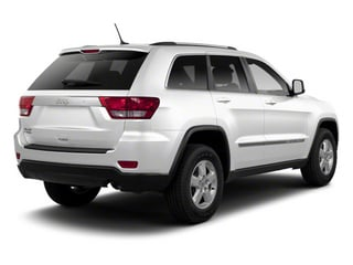 Bright White 2013 Jeep Grand Cherokee Pictures Grand Cherokee Utility 4D Laredo 4WD photos rear view