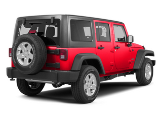 Flame Red 2013 Jeep Wrangler Unlimited Pictures Wrangler Unlimited Utility 4D Unlimited Sahara 4WD photos rear view