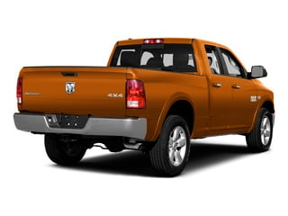 Omaha Orange 2015 Ram Truck 1500 Pictures 1500 Quad Cab SLT 4WD photos rear view