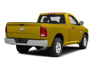 Yellow 2015 Ram Truck 1500 Pictures 1500 Regular Cab SLT 2WD photos rear view