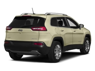Cashmere Pearlcoat 2015 Jeep Cherokee Pictures Cherokee Utility 4D Limited 2WD photos rear view
