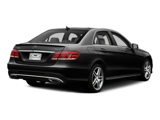 Obsidian Black Metallic 2015 Mercedes-Benz E-Class Pictures E-Class Sedan 4D E400 V6 Turbo photos rear view