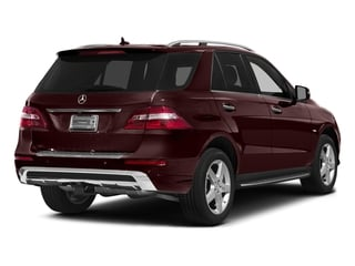 Cinnabar Red Metallic 2015 Mercedes-Benz M-Class Pictures M-Class Utility 4D ML400 AWD V6 Turbo photos rear view