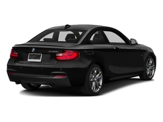 Black Sapphire Metallic 2016 BMW 2 Series Pictures 2 Series Coupe 2D M235i I6 Turbo photos rear view